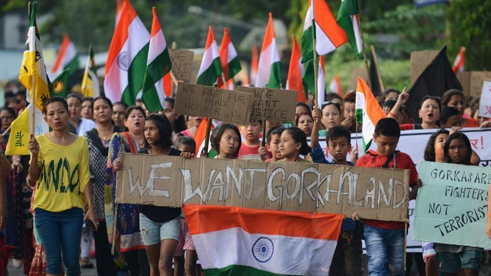 Supporters of the Gorkha Janamukti Morcha chant slogans during a protest rally in support of a separate Gorkhaland state.