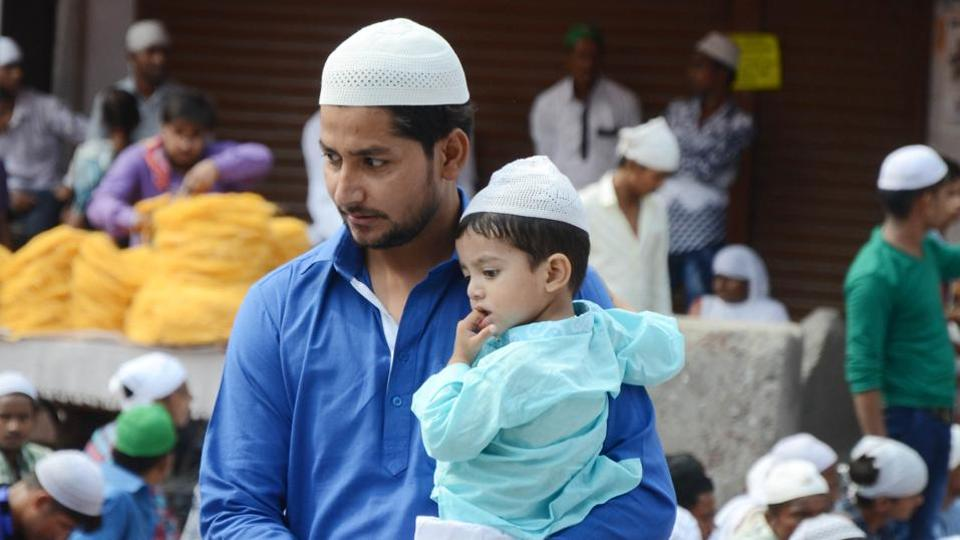 Worshipper with a toddler, celebrating Eid-ul-Fitr,  in Ludhiana on Monday. People wear new clothes on Eid, visit their relatives and friends, and greet each other by saying Eid Mubarak. (Jagtinder Singh Grewal /HT Photo)