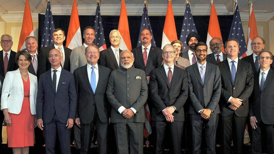 Prime Minister Narendra Modi pose for a group photograph with Indo-US business leaders at a meeting in Washington DC, USA on Sunday.