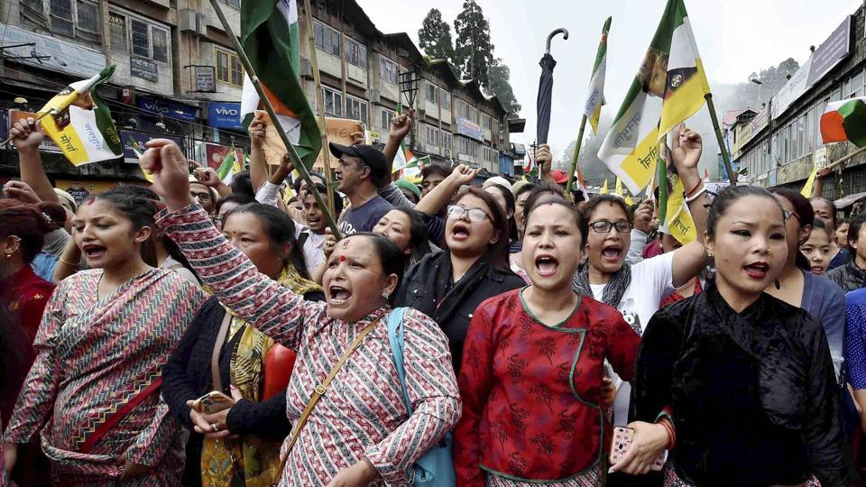 People raise slogans as they participate in a mass rally to demand for separate state of 'Gorkhaland' in Darjeeling.