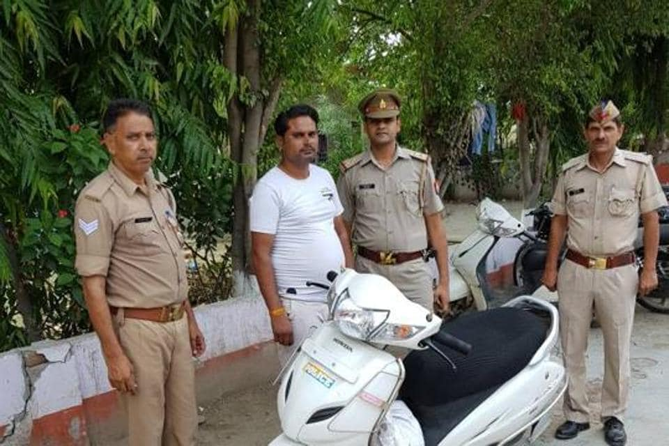 The man, Pankaj Sharma, was held with his two-wheeler that had the word 'police' written on it.
