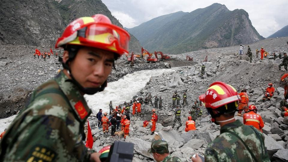 Rescue workers search for survivors at the site of a landslide in the village of Xinmo, Sichuan Province, China. Triggered by heavy rains,the massive landslide buried an entire village with more than ten people confirmed dead and 93 still missing. The landslide carried an estimated 18 million cubic metres of earth and rock equivalent to more than 7,200 Olympic-sized swimming pools. On Monday,villagers in China visited what used to be their relatives' homes to mourn for their loved ones.  (REUTERS)