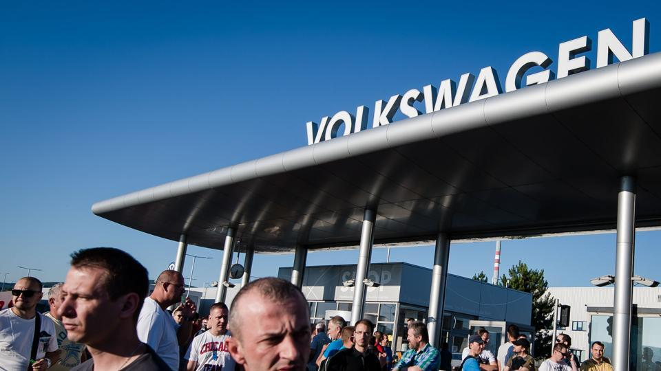 Workers at Volkswagen Slovakia attend a rally at the start of a strike over unmet demands for a 16% pay rise from the country's largest private employer on June 20, 2017.