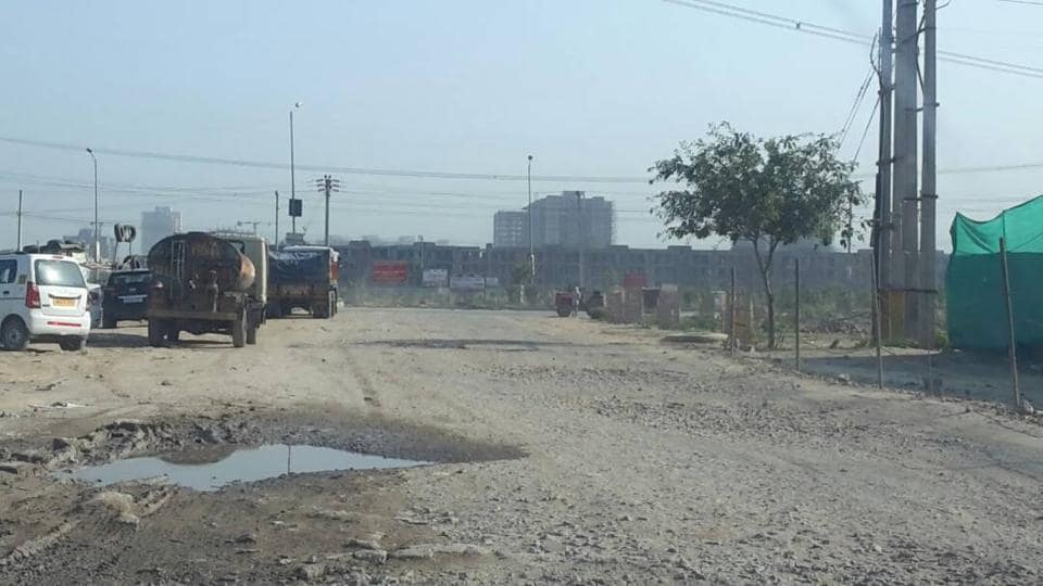 Thousands of residents of sectors 69, 70 and 71 take this broken road to reach Badshahpur Chowk.