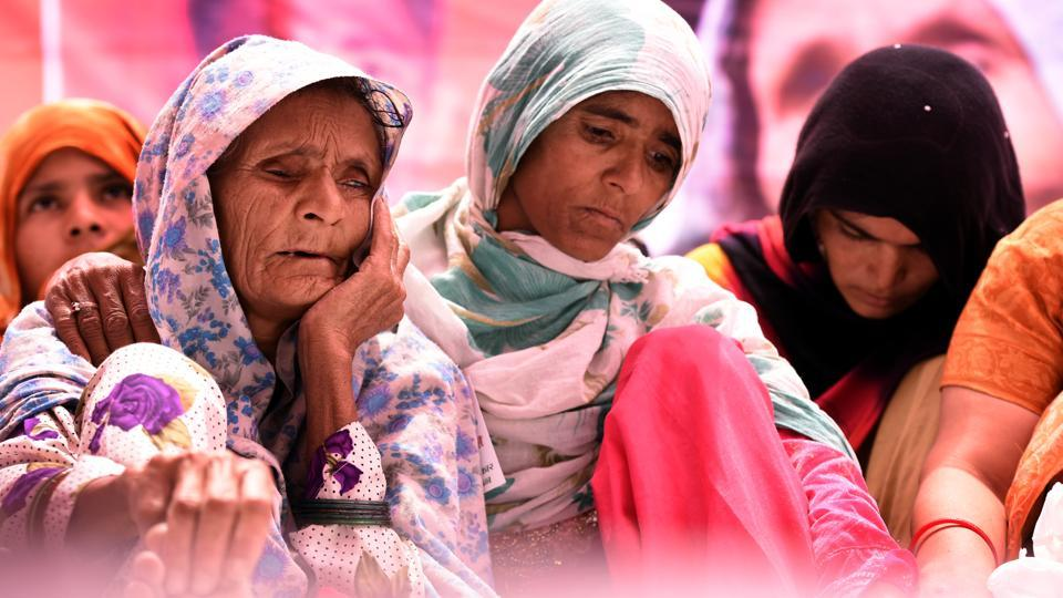 Family members of Pehlu Khan, a dairy farmer who was allegedly lynched by vigilantes for transporting cows in Rajasthan in April, sit on a dharna to demand justice for him. In recent months, a string of deadly mob attacks on Muslims has triggered outrage across India, with critics accusing the Narendra Modi government of not doing enough to stop these assaults.