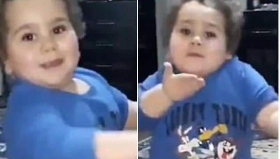Wearing a blue t-shirt and yellow trousers, the pre-schooler can be seen shaking a leg to a traditional song, clapping his hands in rhythm with the beat.  (@I7sannFt  Twitter\Screengrab)
