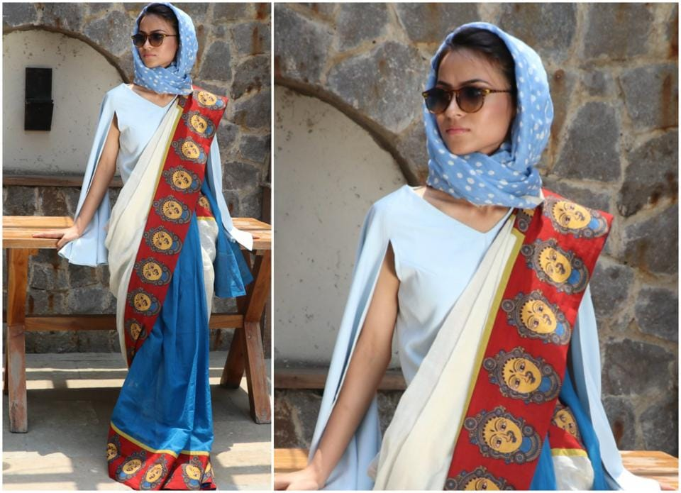 Model Gulpana Anwar Hussain wears a cotton sari with bright Kalamkari motifs. Her powder blue head scarf, slit bell sleeved blouse and retro glasses give her look a cool Audrey Hepburn vibe.  (HT Photo/ Shara Ashraf; Styling: shara ashraf ; makeup:  Aashmeen Munjaal)