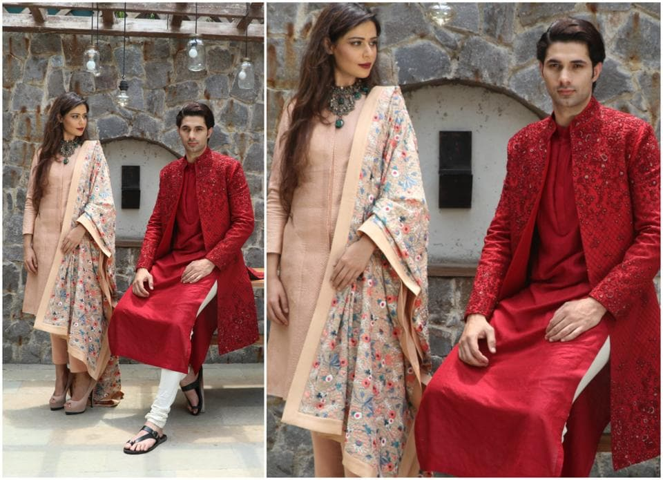 Model Samiksha Singh wears a beige jacket paired with cigarette pants, an embroidered dupatta and an elaborate necklace with dainty Ganeshas. Model Amit Dahiya wears a sleek red kurta teamed with off-white churidaar and a wine red sherwani. (HT Photo/ Shara Ashraf and Akshay Kaushal)