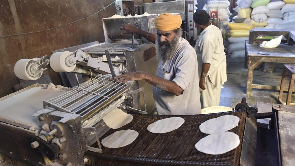 A chapati-making machine at work in the community kitchen in Golden Temple.