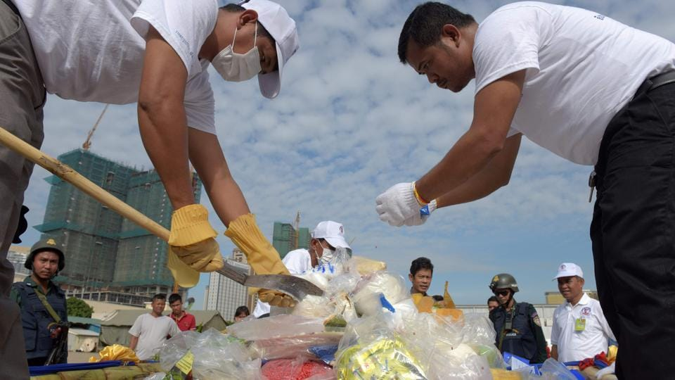 Cambodian National Authority for Combating Drugs officials prepare drugs for a destruction ceremony to mark the UN's International Day against Drug Abuse and Illicit Trafficking in Phnom Penh.  (AFP)