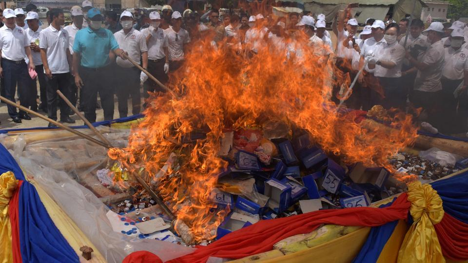 Cambodian officials burn a pile of drugs during a destruction ceremony in Phnom Penh. (AFP)