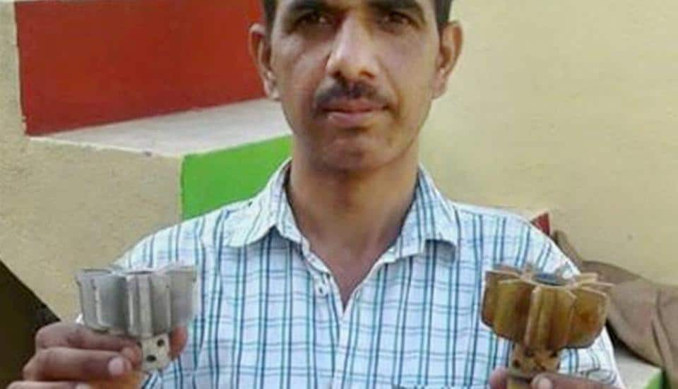 A man shows the remains of mortar shells fired by Pakistan at Line of Control (LoC) in Noweshra sector of Rajouri district on Sunday.