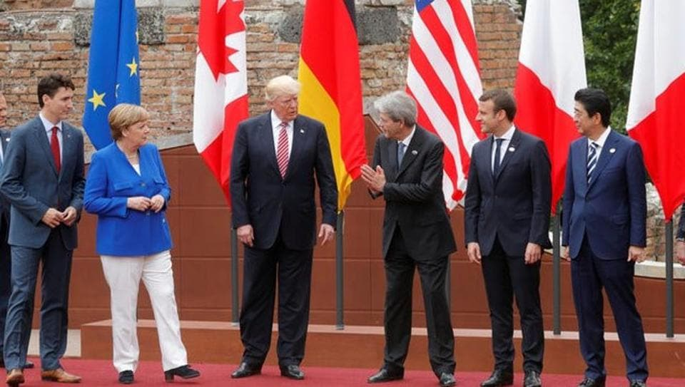 From L-R, European Council President Donald Tusk, Canadian Prime Minister Justin Trudeau, German Chancellor Angela Merkel, U.S. President Donald Trump, Italian Prime Minister Paolo Gentiloni, French President Emmanuel Macron, Japanese Prime Minister Shinzo Abe react during a family photo during the G7 Summit in Taormina, Sicily.