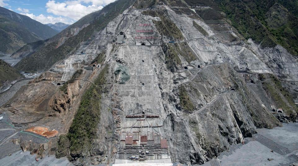 A view of the construction site of the Lianghekou dam near Hekou in China's Sichuan province.The colossal construction site which swallows three rivers is another display of engineering prowess and also the stress inflicted on people and nature along the way. Once completed in 2023, the 295-metre tall behemoth will be the world's third tallest dam, producing 3,000 megawatts of energy. However, engineers and environmentalists also worry that Sichuan, which is a hotbed of seismic activity could damage hydropower stations.  (AFP)