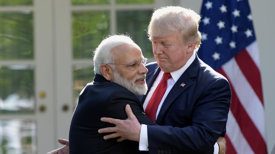 President Donald Trump and Prime Minister Narendra Modi hug while making statements in the Rose Garden of the White House in Washington.