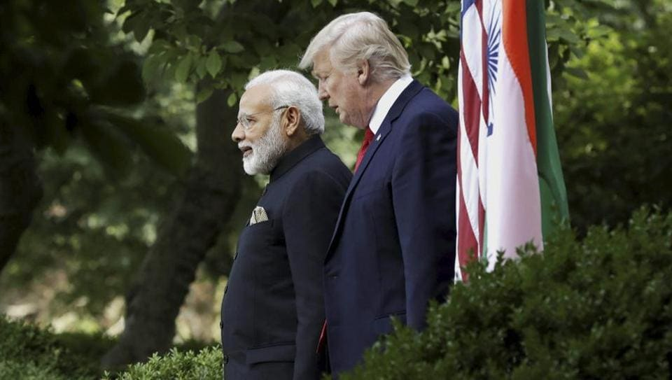 President Donald Trump walks to a joint statement in the Rose Garden with Indian Prime Minister Narendra Modi at the White House, Monday.