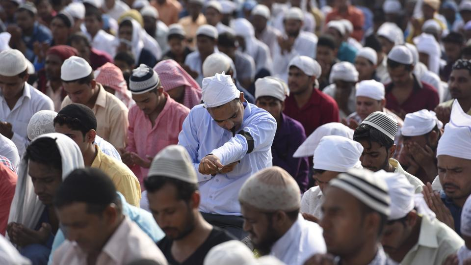 Muslims offer Eid prayers wearing a black band as a mark of protest, after 15-year-old Junaid Khan was killed after a scuffle which broke out in a train, June 26, 2017