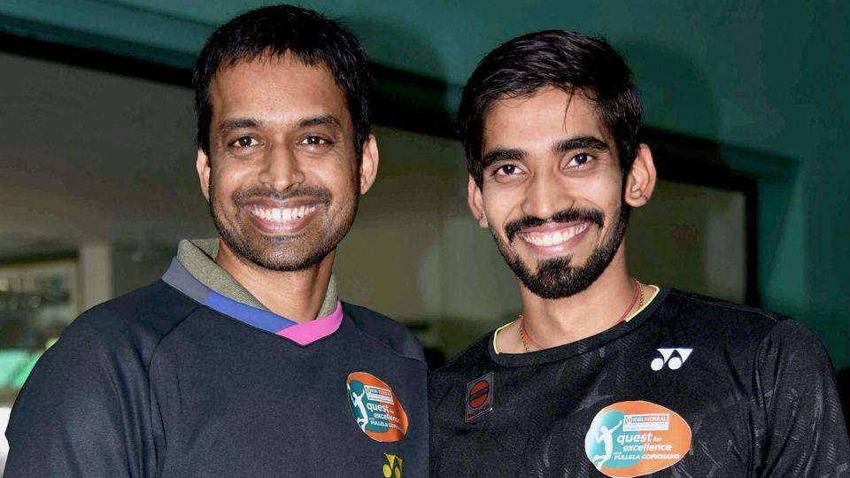 Chief national badminton coach Pullela GopiChand greets Kidambi Srikanth, the winner of Indonesian Open and Australian Open, in Hyderabad on Tuesday.