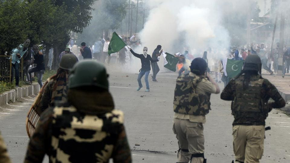 Kashmiri protestors clash with army forces after Eid prayers in Srinagar on Monday.