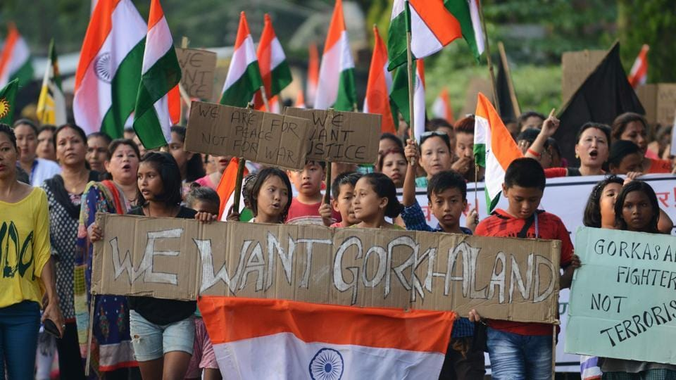 Gorkha Janamukti Morcha supporters hold a protest rally in support of a separate Gorkhaland state.