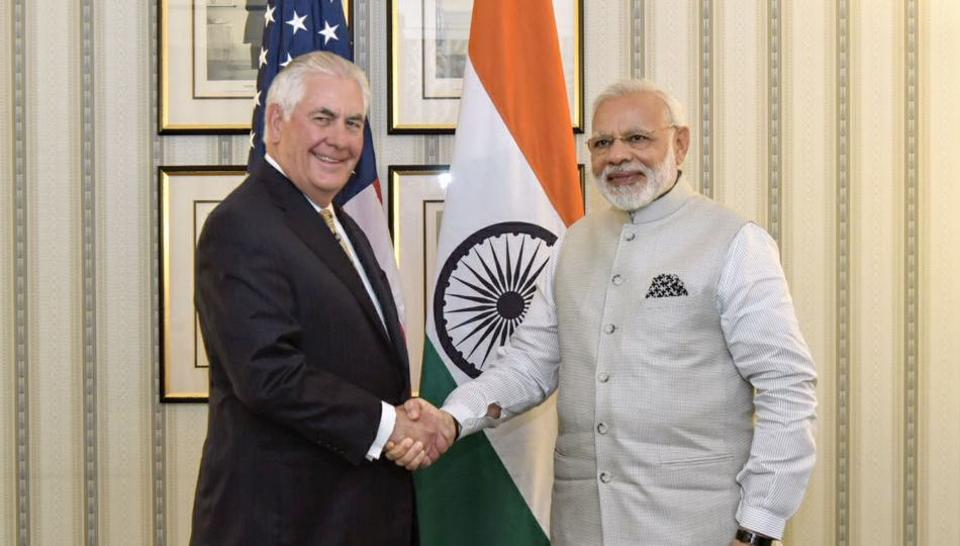 In this photograph released by the Indian Press Information Bureau on June 26, 2017, US Secretary of State Rex W. Tillerson shakes hands with Indian Prime Minister Narendra Modi in Washington DC.