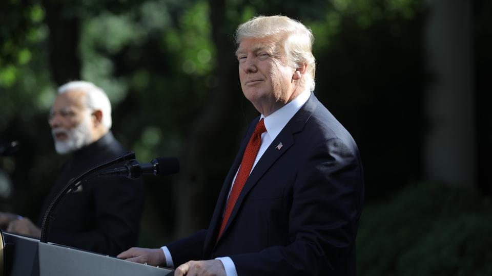 US President Donald Trump (R) holds a joint news conference with Indian Prime Minister Narendra Modi in the Rose Garden of the White House in Washington.