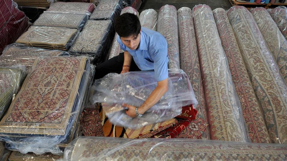 The trade of these carpets competes twofold - locally between the hand tufted artisanal rugs and machine loomed pieces manufactured in Jammu and Kashmir as well as with international pieces that vie for the high prises these carpets can fetch. (Nitin Kanotra/HT Photo)