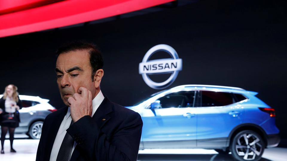 Carlos Ghosn, chairman and CEO of the Renault-Nissan Alliance gestures before an interview during the Geneva Motor Show.
