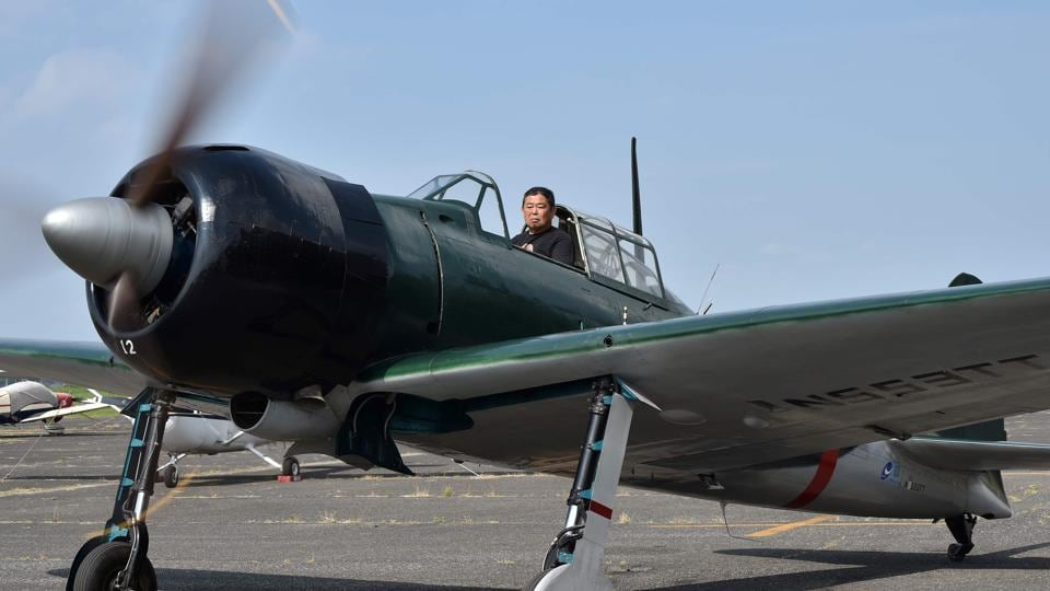 Japanese pilot Kazuaki Yanagida in the restored World War 2-era Mitsubishi A6M Type 22 Zero fighter at an airfield in Ryugasaki, Ibaraki Prefecture. Plucked from the Papua New Guinean jungle, the restored Zero fighter has taken to the skies over the land that gave birth to the once-feared warplane.