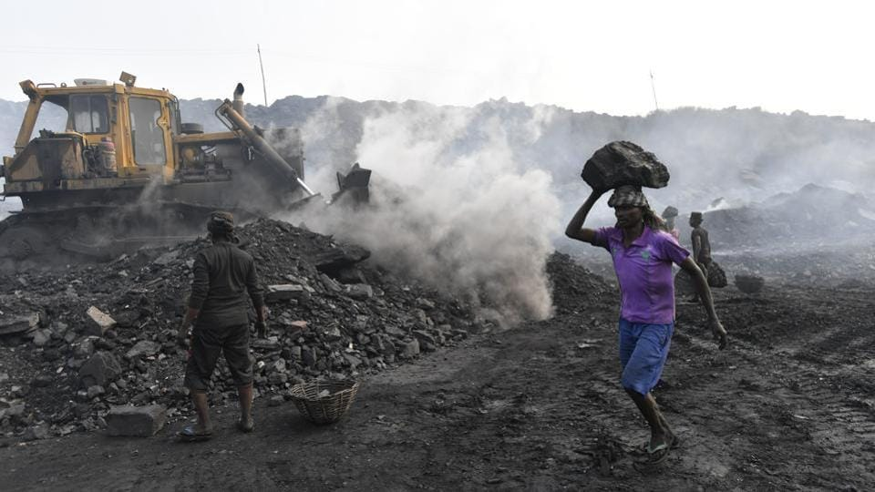 People work in an open-cast coal mine at Jharia in Jharkhand.