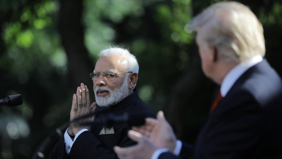 Trump (R) applauds Indian Prime Minister Narendra Modi during their joint news conference in the Rose Garden of the White House. During his visit, Modi will try to strengthen ties that have appeared to loosen.  (Carlos Barria/REUTERS)