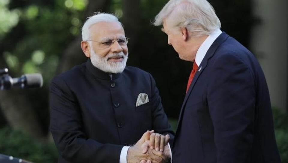 US President Donald Trump (R) greets Indian Prime Minister Narendra Modi during their joint news conference in the Rose Garden of the White House in Washington.