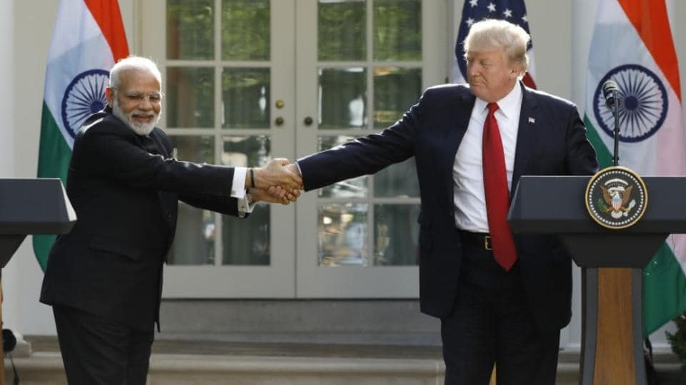 U.S. President Donald Trump (R) greets Indian Prime Minister Narendra Modi during their joint news conference in the Rose Garden of the White House in Washington. (Kevin Lamarque/Reuters)