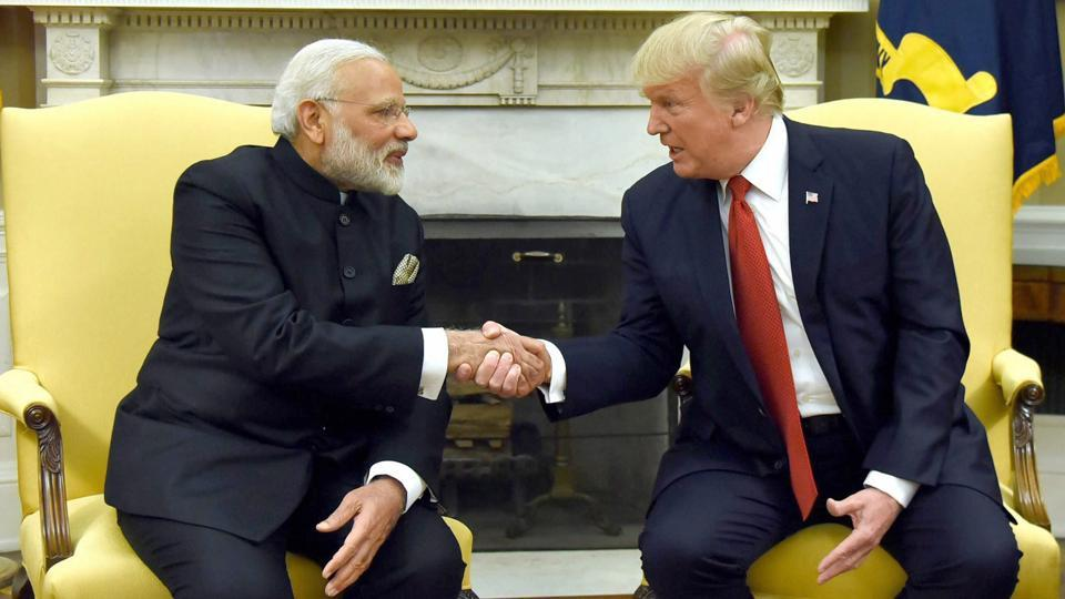 US President Donald Trump shakes hands with Indian Prime Minister Narendra Modi as they begin a meeting in the Oval Office of the White House in Washington. (PTI)