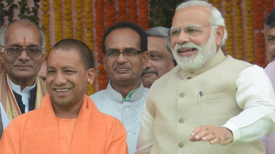 PMModi and Yogi Adityanath as he was sworn-in as the Uttar Pradesh CM.
