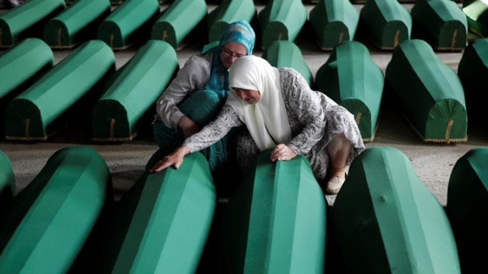Muslim women cry near coffins of their relatives, who are newly identified victims of the 1995 Srebrenica massacre, which are lined up for a joint burial in Potocari near Srebrenica, Bosnia and Herzegovina.