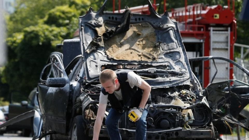 An investigator works at the scene of a car bomb explosion which killed Maksim Shapoval, a high-ranking official involved in military intelligence, in Kiev, Ukraine.