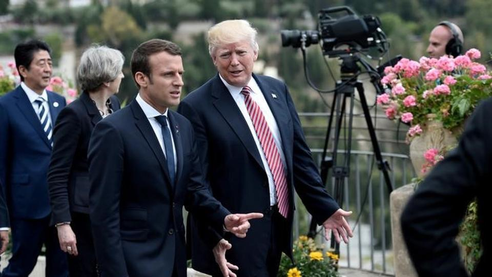 US President Donald Trump (R) with French President Emmanuel Macron.