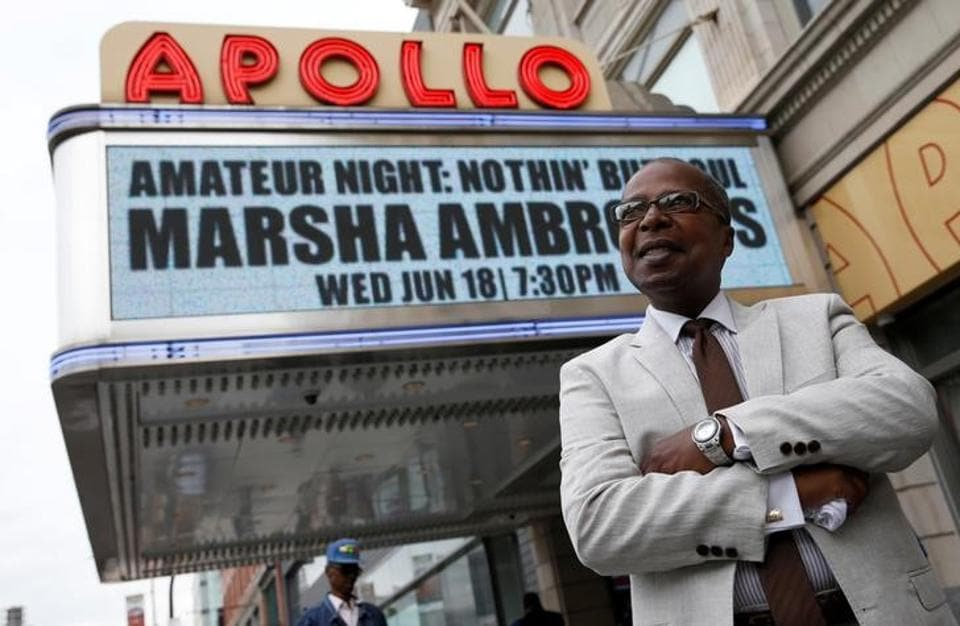 Historian Billy Mitchell posing outside the Apollo Theater in the Harlem section of New York in June 2014.