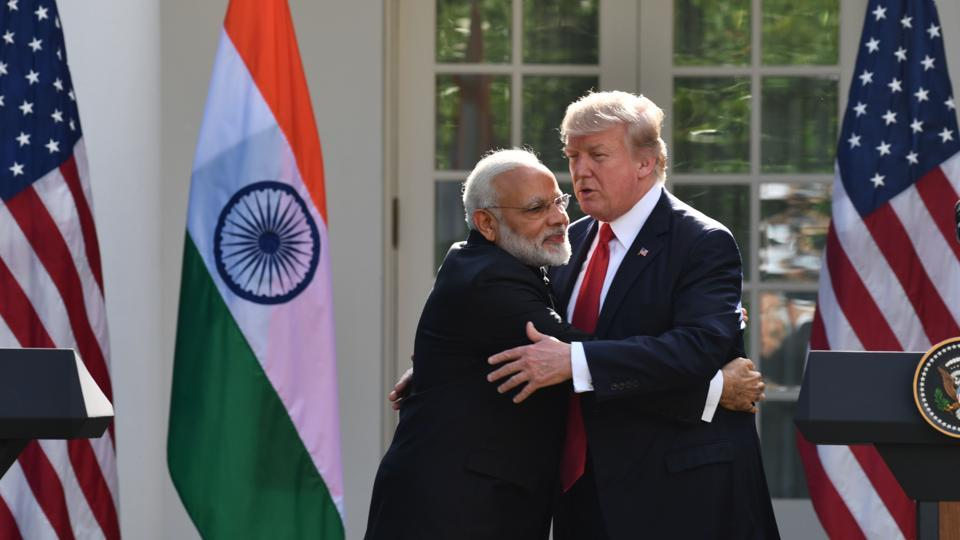 US President Donald Trump and Indian Prime Minister Narendra Modi embrace during a joint press conference in the Rose Garden at the White House in Washington, DC.