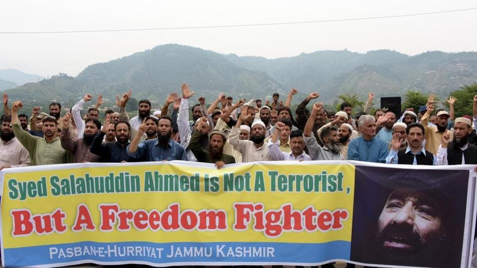 Pakistani activists carry a banner as they shout slogans duringa protest against United States' sanctions on Syed Salahuddin.
