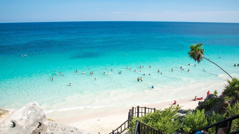 There are a number of yoga retreat centres you could check into at the Tulum beach in Mexico.