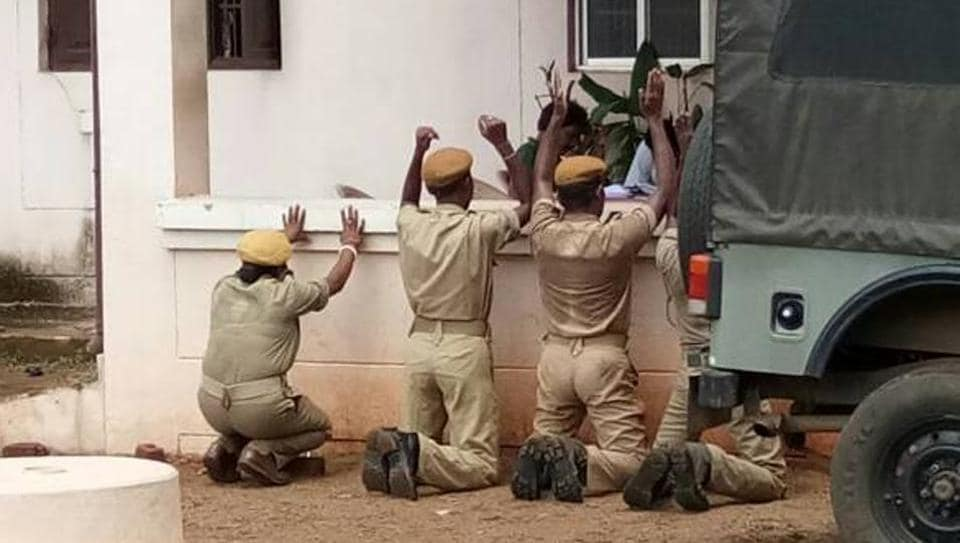 Four home guards, including a woman, were seen kneeling down, and the photo went viral on social media.