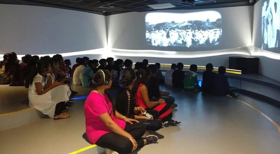 Visitors at a multimedia show held at Dandi Kutir.