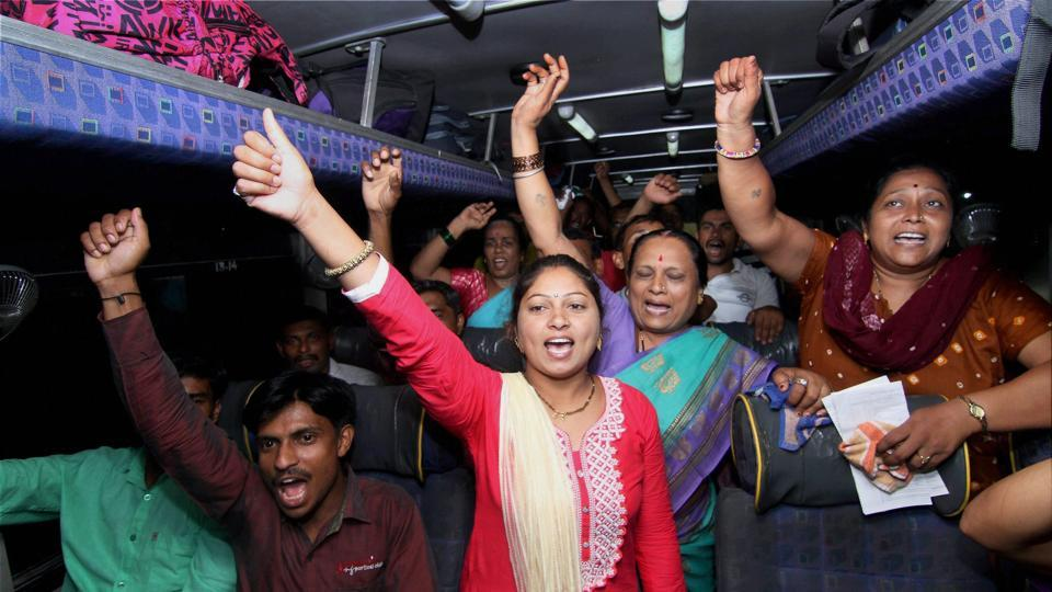 Devotees shout religious slogans in a bus as the first batch of pilgrims left for Amarnath Yatra, in Jammu.  (PTI)