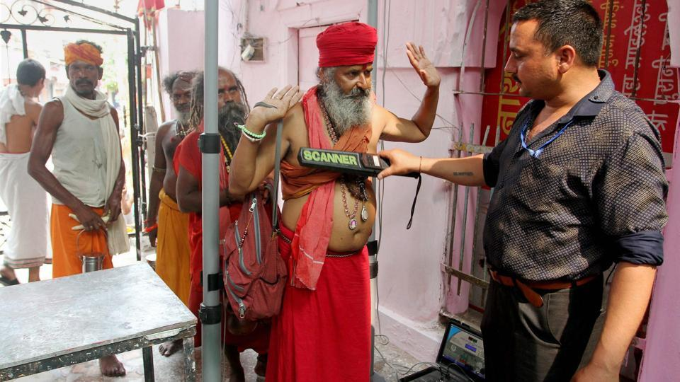 Sadhus undergo a security check before getting registered for the annual Amarnath Yatra at Ram Mandir base camp in Jammu. The first batch of Amarnath pilgrims left here for the cave shrine in the Kashmir Valley amid extraordinary security arrangements. The 40-day yatra will culminate on August 7 on Raksha Bandhan. There are two routes: the traditional 28.2 km long Pahalgam route in Anantnag district, while the Baltal track in Ganderbal district is a 9.5 km-stretch.  (PTI)