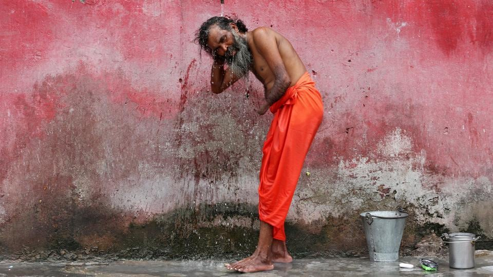 A Sadhu or a Hindu holy man bathes before registering for the annual pilgrimage to the Amarnath cave shrine, at a base camp in Jammu. (REUTERS)