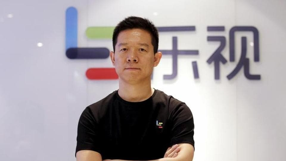Jia Yueting, co-founder and head of Le Holdings Co Ltd, also known as LeEco and formerly as LeTV, poses for a photo in front of a logo of his company after a Reuters interview at LeEco headquarters in Beijing.