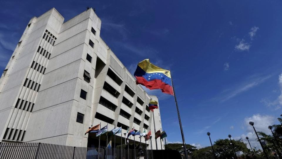 A man walks in front of a building of the Venezuela Supreme Court in Caracas.
