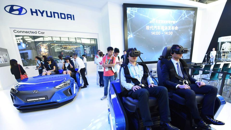 Visitors use virtual reality headsets on the the Hyundai stand on the opening day of the Consumer Electronics Show Asia in Shanghai. The three-day show features 450 exhibitors from 22 countries and territories, showcasing the latest in technological innovations.